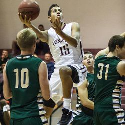 Lone Peak's Frank Jackson goes up for two at Lone Peak gym.