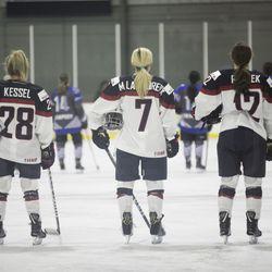 Team USA forward Amanda Kessel, Team USA forward Monique Lamoureux-Morando, Team USA forward Kelly Pannek during the National Anthem.
