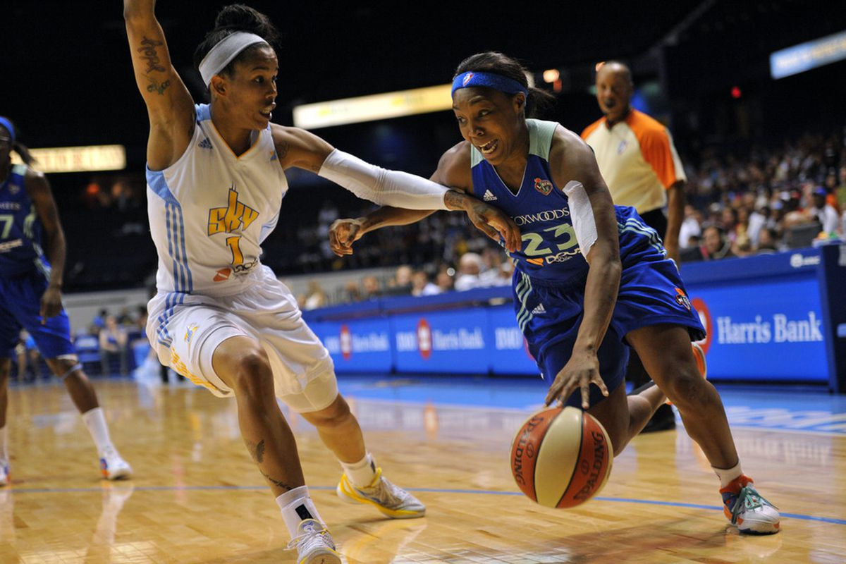 July 6, 2012; Chicago, IL, USA; New York Liberty guard Cappie Pondexter (23) is defended by Chicago Sky forward Tamera Young (1) during the first half at the Allstate Arena.  <em>Photo by Rob Grabowski-US PRESSWIRE.</em>