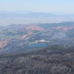 This Tuesday, Jan. 27, 2017, photo taken by Tim Roide, Incident Commander, shows an aerial view of burnout area around Yankee Meadow, in southern Utah. In Utah, firefighters hope Wednesday, June 28, 2017, to douse areas with intense blazes at the Utah fire's southern end so residents can return to homes in the town of Brian Head. Homes there have been evacuated since June 17 since authorities said the fire was started by someone using a torch tool to burn weeds on private land.