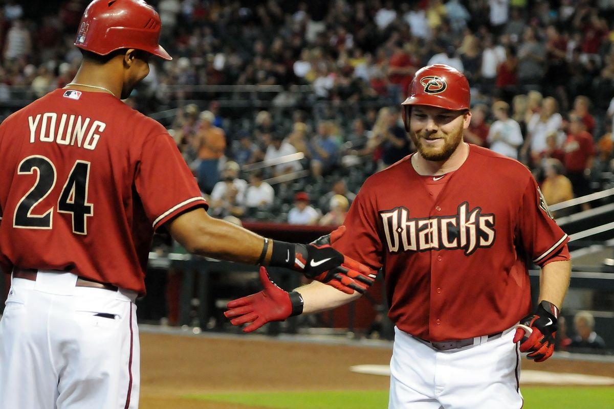 PHOENIX, AZ - JULY 22:  Jason Kubel #13 and teammate Chris Young #24 of the Arizona Diamondbacks celebrate a home run against the Houston Astros at Chase Field on July 22, 2012 in Phoenix, Arizona.  (Photo by Norm Hall/Getty Images)