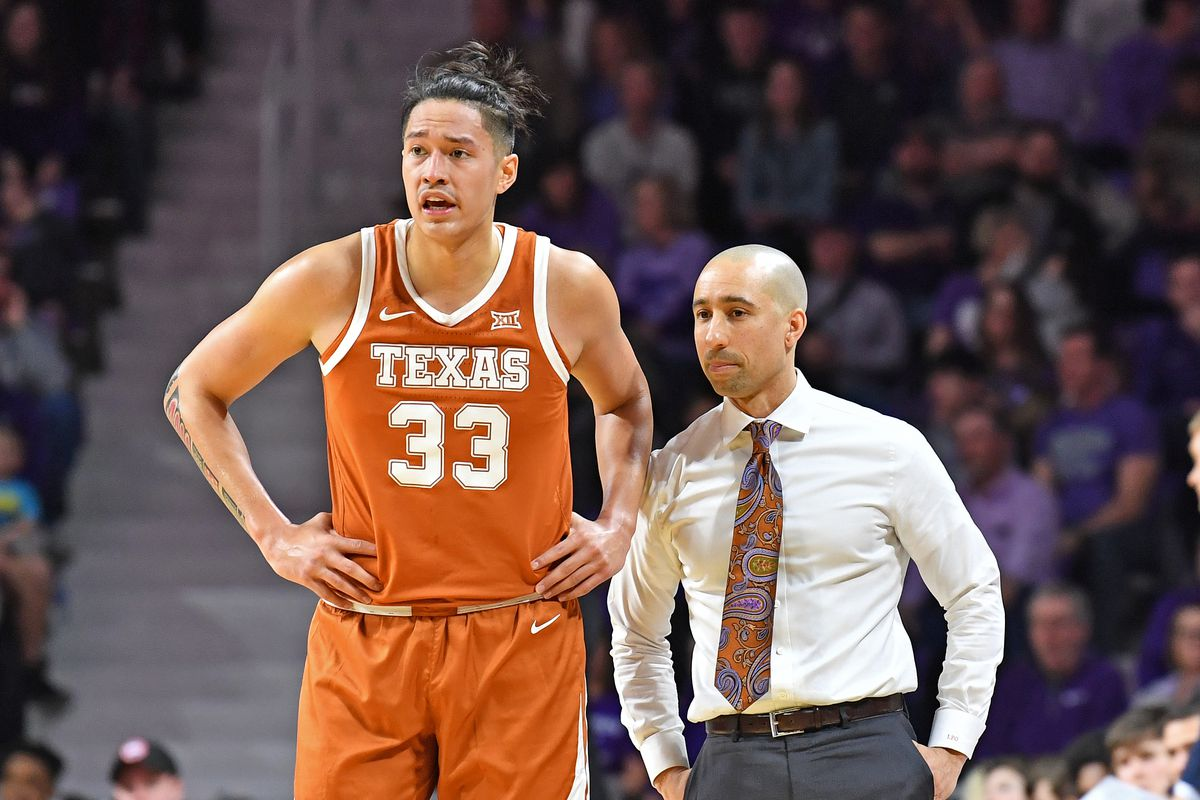 Head coach Shaka Smart of the Texas Longhorns talks with Kamaka Hepa during the first half against the Kansas State Wildcats at Bramlage Coliseum on February 22, 2020 in Manhattan, Kansas.