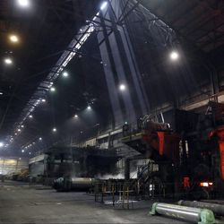 Rays of light shine through the ceiling as steel passes through a hot-strip mill at the U.S. Steel Granite City Works facility Thursday, June 28, 2018, in Granite City, Ill.   AP Photo/Jeff Roberson
