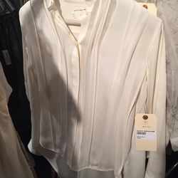 Cream long sleeve blouse, $100