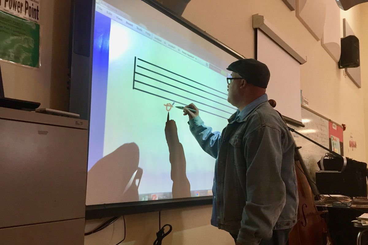 Music teacher Quincy Stewart incorporates math, writing and history in his music classes at Detroit's Central High School.