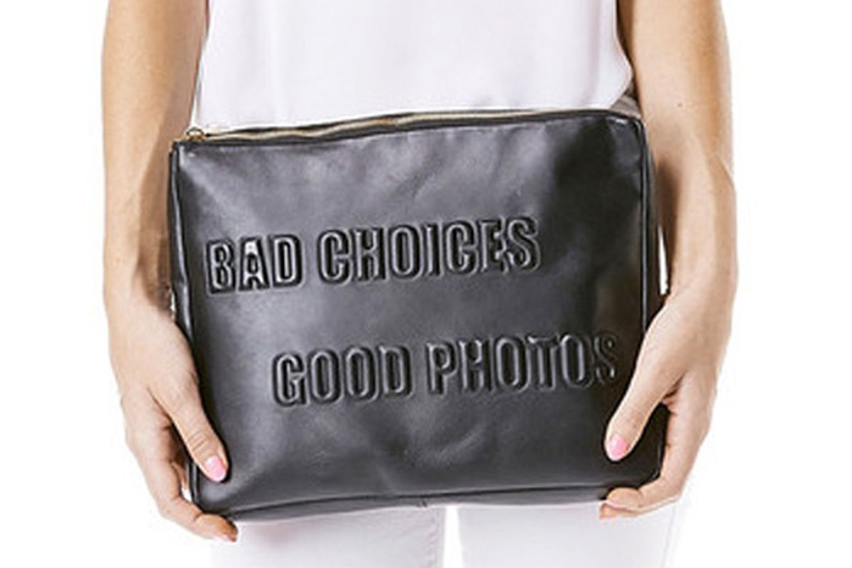 """Donatienne Haylie bag, <a href=""""http://donatiennehandbags.com/collections/new/products/haylie-black#.VIdWHmTF_xg"""">$405</a>."""