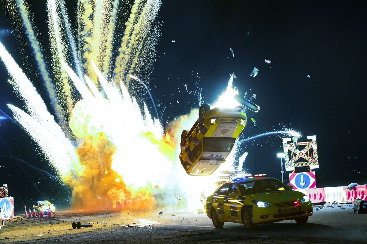 An explosion totals two cars.
