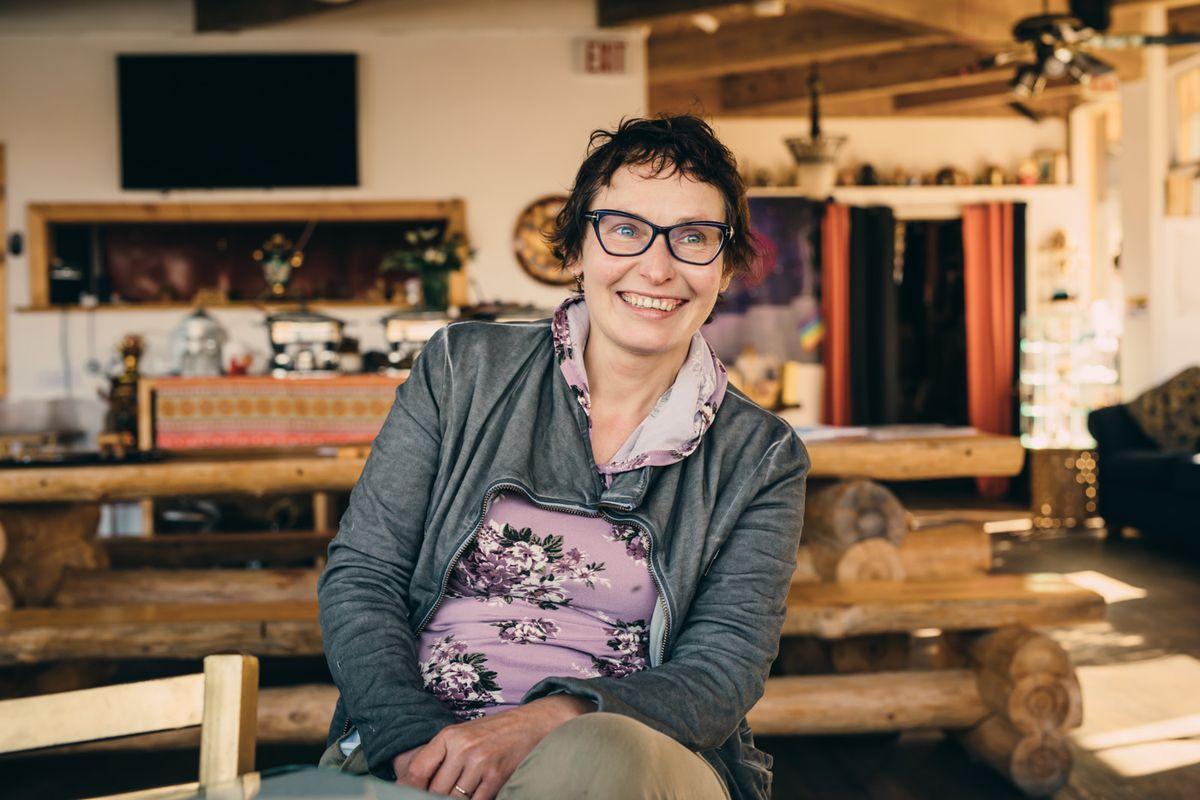 Russian House #1 co-founder Polina Krasikova smiles while sitting inside the restaurant
