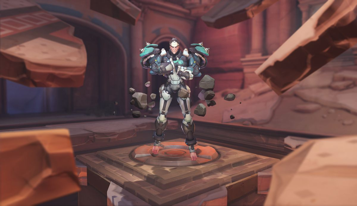 The new hero Sigma hovers in the desert map Petra in a screenshot of Overwatch