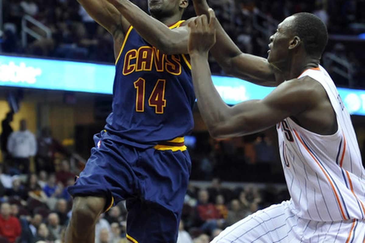 Apr 10, 2012; Cleveland, OH, USA; Cleveland Cavaliers guard Lester Hudson (14) scores against Charlotte Bobcats center Bismack Biyombo (0) in the fourth quarter at Quicken Loans Arena. Mandatory Credit: David Richard-US PRESSWIRE