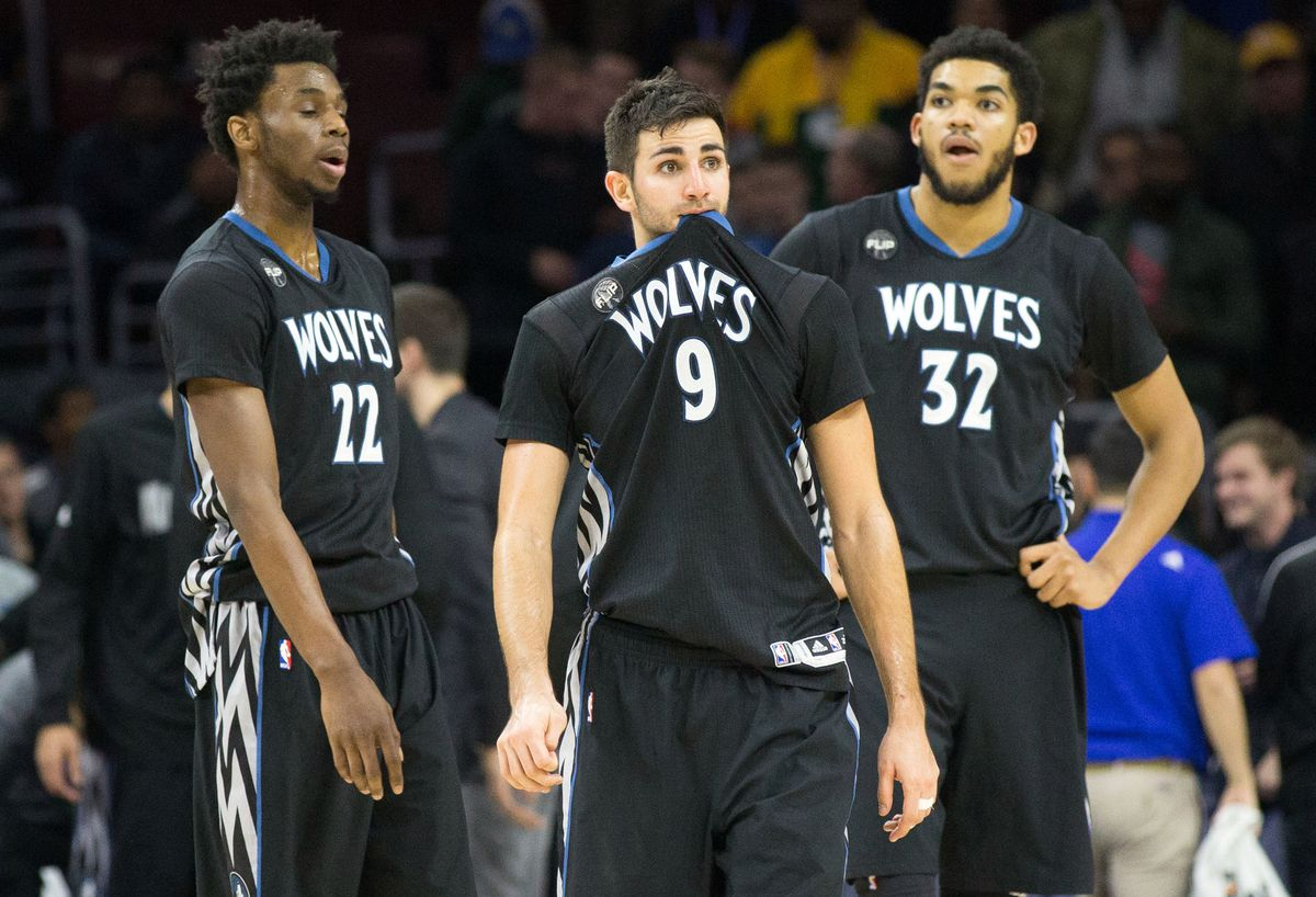 Andrew Wiggins, Ricky Rubio, and Karl-Anthony Towns looking disappointed