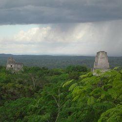Rain falls over ancient Maya ruins near Tikal, Guatemala.