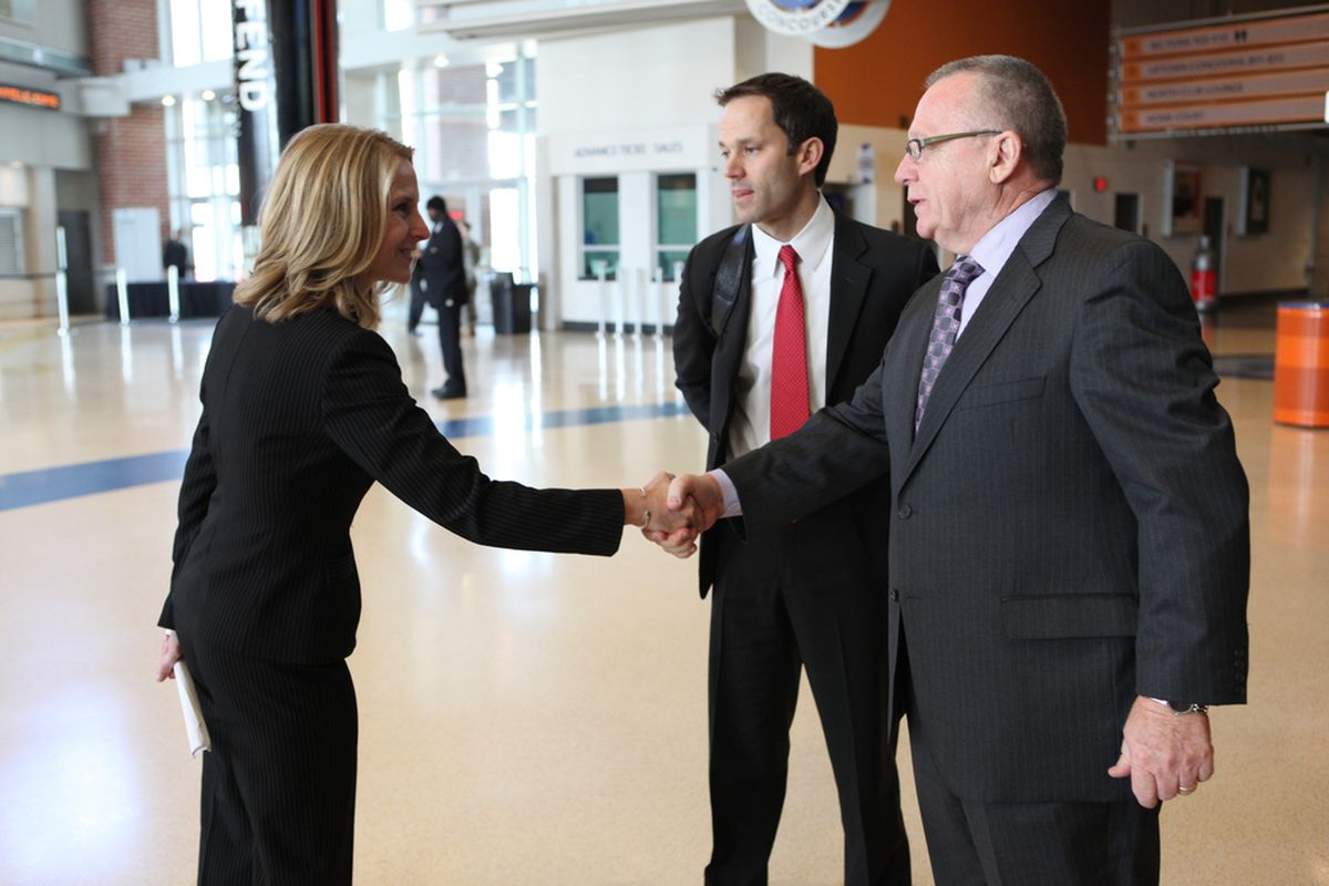 Charlotte Checkers' COO Tera Black welcomes the Carolina Hurricanes' GM Jim Rutherford and Assistant GM Jason Karmanos to the Time Warner Cable Arena in Charlotte, NC, February 10, 2010. (photo courtesy of Charlotte Checkers)