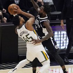 Utah Jazz guard Donovan Mitchell, left, tries to shoot as Los Angeles Clippers guard Patrick Beverley defends during the second half in Game 6 of a second-round NBA basketball playoff series Friday, June 18, 2021, in Los Angeles.