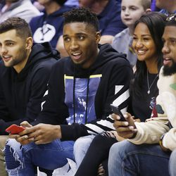 Utah Jazz players Raul Neto, Donovan Mitchell and Royce O'Neal attend the BYU game in Provo on Thursday, Dec. 28, 2017. BYU won 69-45.