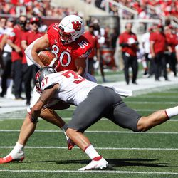 Utah tight end Brant Kuithe (80) gets tackled by Washington State linebacker Justus Rogers while running for a touchdown during an NCAA college football game at Rice-Eccles Stadium on Saturday, Sept. 25, 2021 in Salt Lake City. Utah won the game 24-13.