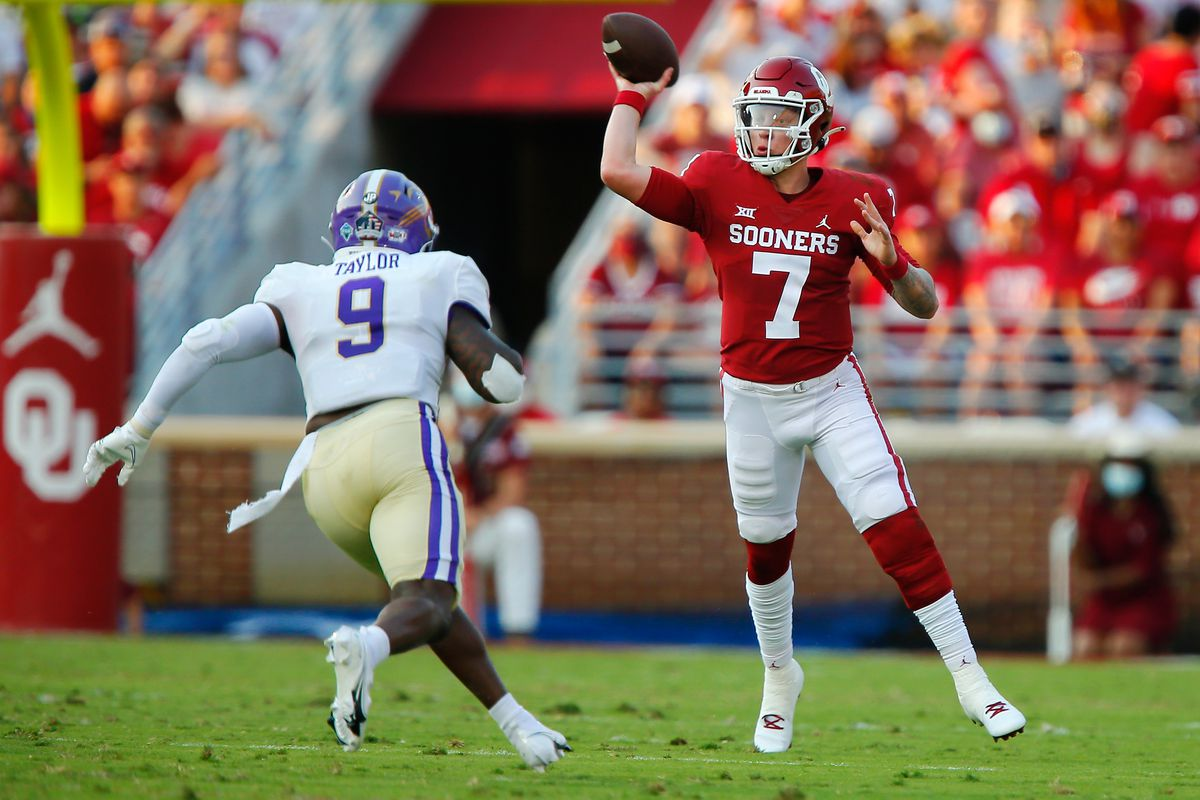 Quarterback Spencer Rattler #7 of the Oklahoma Sooners throws the ball as he is approached by linebacker Kareem Taylor #9 of the Western Carolina Catamounts in the first quarter at Gaylord Family Oklahoma Memorial Stadium on September 11, 2021 in Norman, Oklahoma.