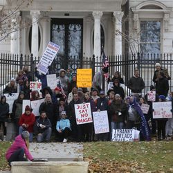 Protesters prepare to take a self-timed group photo while gathered outside of the Governor's Mansion in Salt Lake City on Monday, Nov. 9, 2020. They were at the mansion to protest Gov. Gary Herbert's mask mandate and new COVID-19 restrictions.