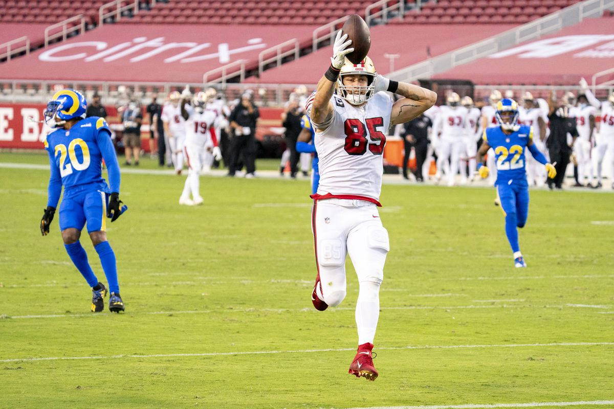 San Francisco 49ers tight end George Kittle (85) scores a touchdown against the Los Angeles Rams during the second quarter at Levi's Stadium.