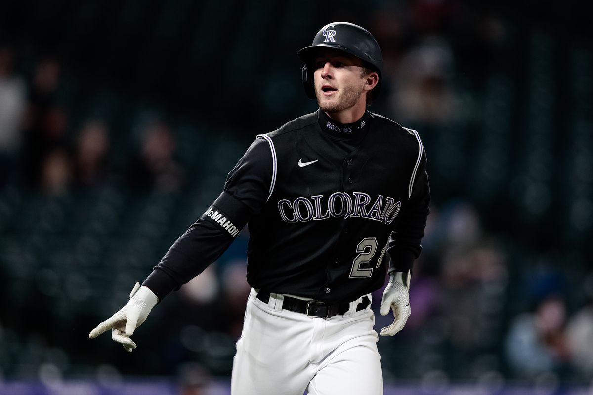 Colorado Rockies third baseman Ryan McMahon (24) gestures as he rounds the bases on a solo home run in the second inning against the Arizona Diamondbacks at Coors Field.