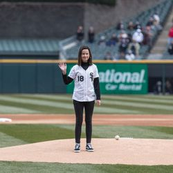 Grace Bauer, the 13-year-old daughter of slain Chicago Police Commander Paul Bauer, places the game ball on the mound. | Erin Brown/Sun-Times