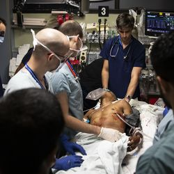 Emergency room doctors at Mount Sinai Hospital insert a chest tube to treat a lung that collapsed after a man was stabbed on the Southwest Side, Tuesday evening, Sept. 10, 2019.