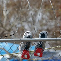 Shoes dry on a fence surrounding the migrant camp in Matamoros, Tamaulipas, Mexico, on Tuesday, Feb. 23, 2021.