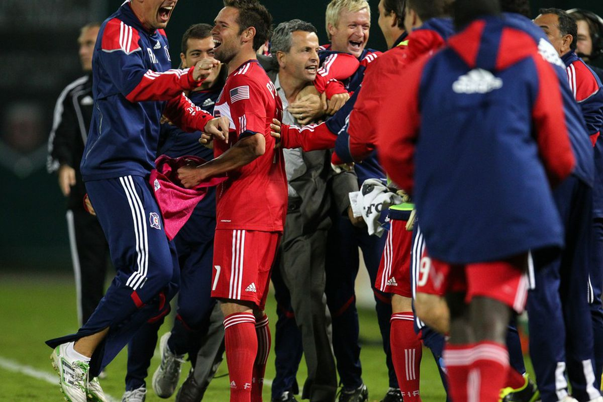 WASHINGTON, DC - OCTOBER 15: Head coach Frank Klopas and the bench of the Chicago Fire celebrate after a goal against D.C. United at RFK Stadium on October 15, 2011 in Washington, DC. (Photo by Ned Dishman/Getty Images)