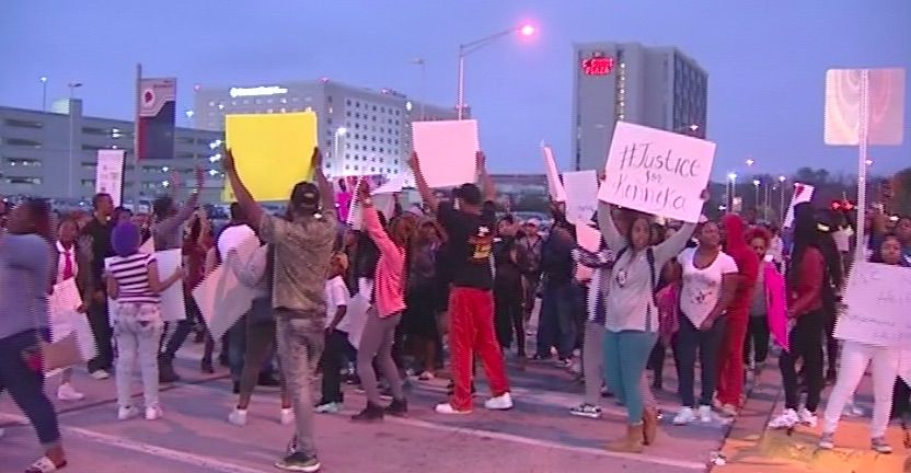 Protesters who claim there was foul play in Kenneka Jenkins' death march down River Road near the Crowne Plaza hotel in Rosemont on Wednesday night. | Network Video Productions