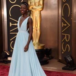 "Lupita Nyong'o looking gorgeous in custom Prada. ""This blue reminds me of Nairobi,"" she explains."