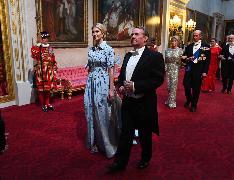 Ivanka Trump and UK Secretary of State for International Trade Liam Fox walk through the East Gallery toward the ballroom of Buckingham Palace for a state banquet on June 3, 2019, in London, England.