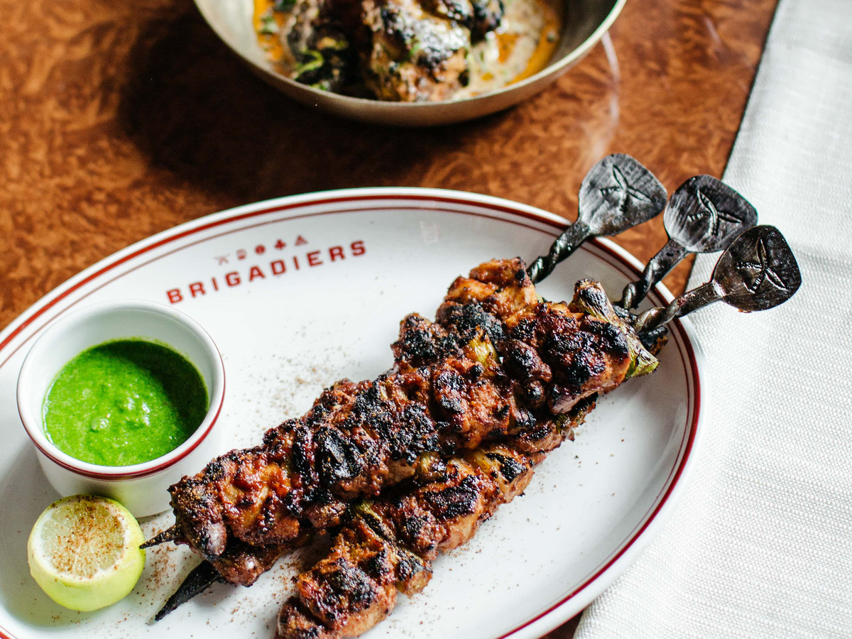 Kebabs on a white plate at Brigadiers, one of London's best Modern Indian restaurants —owed by JKS Restaurants, the group behind Michelin-starred Gymkhana and Trishna, as well as Hoppers in Soho and Marylebone
