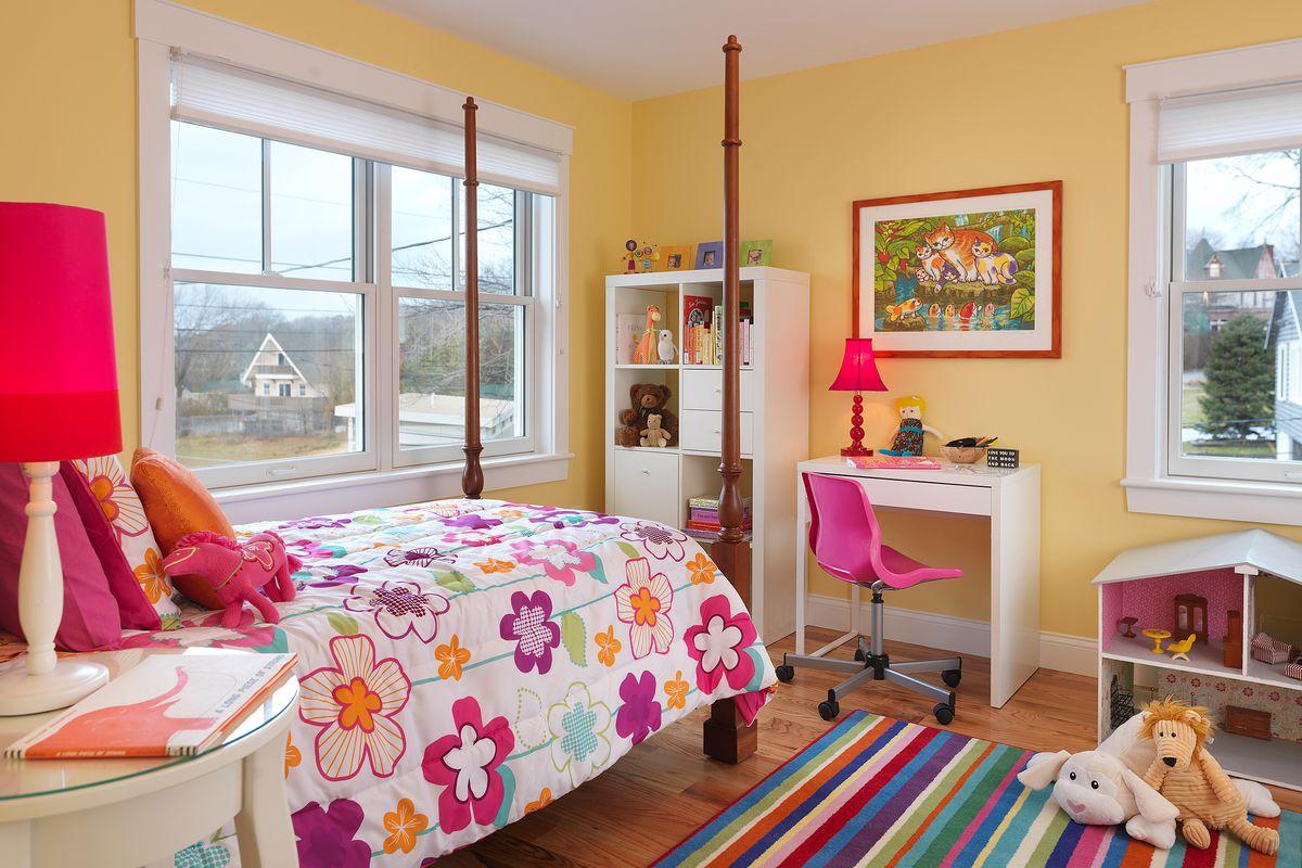 Child's colorful bedroom above garage.