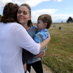 Traci Mariano, Jordan School District administrative assistant, hugs Tessa Stitzer and her son, Drake Stitzer goodbye at the Bingham City Cemetery in South Jordan on Thursday, May 25, 2017. The Jordan School Board has deeded the pioneer cemetery to Copperton Township after 44 years as owner and caretaker. Stitzer serves on the township council and was insistent that the township reassume ownership.