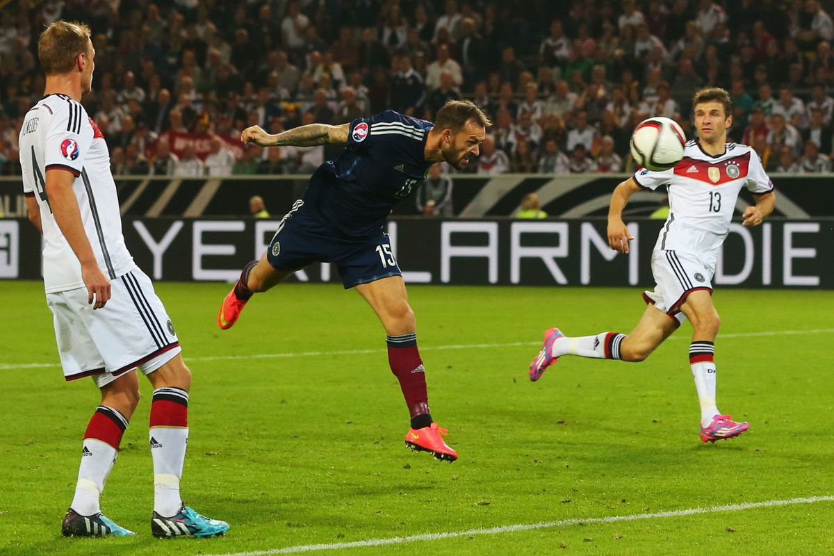 Fletcher stoops to head towards goal against Germany
