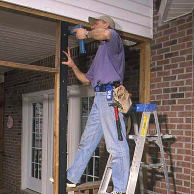Man Installing Vertical Base Strips For Screened In Porch