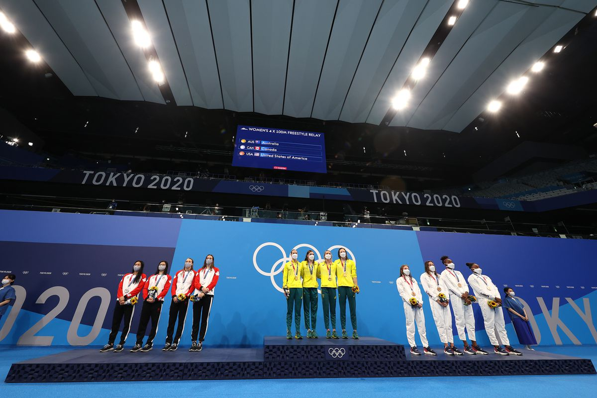 Silver medalists Kayla Sanchez, Margaret Macneil, Rebecca Smith and Penny Oleksiak of Team Canada; gold medalists Bronte Campbell, Meg Harris, Emma Mckeon and Cate Campbell of Team Australia; and bronze medalists Erika Brown, Abbey Weitzeil, Natalie Hinds and Simone Manuel of Team United States pose on the podium for the Women's 4 x 100m Freestyle Relay Final on day two of the Tokyo 2020 Olympic Games at Tokyo Aquatics Centre on July 25, 2021 in Tokyo, Japan.