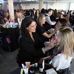 Lauren Mager from Philosophy works with Jade Bonomo at right during the Nordstrom Beauty Bash at City Creek Center in Salt Lake City, Thursday, March 22, 2012.