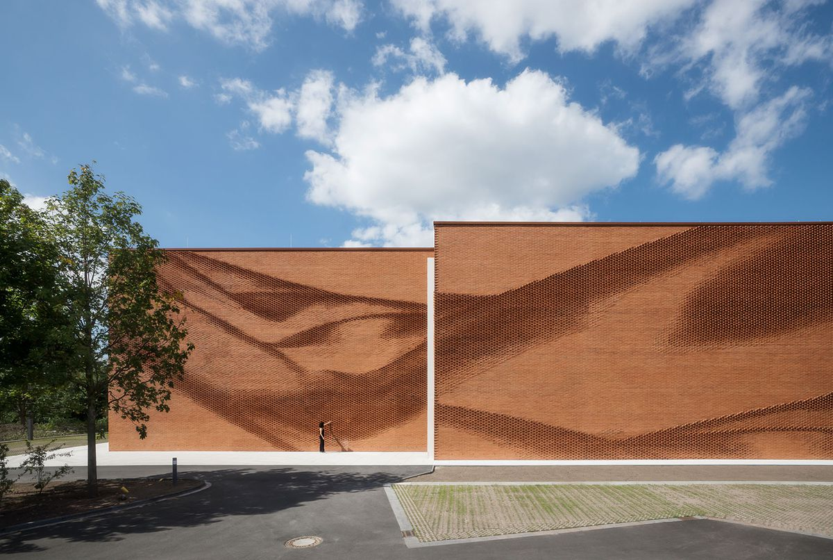 Red brick facade with optical illusion