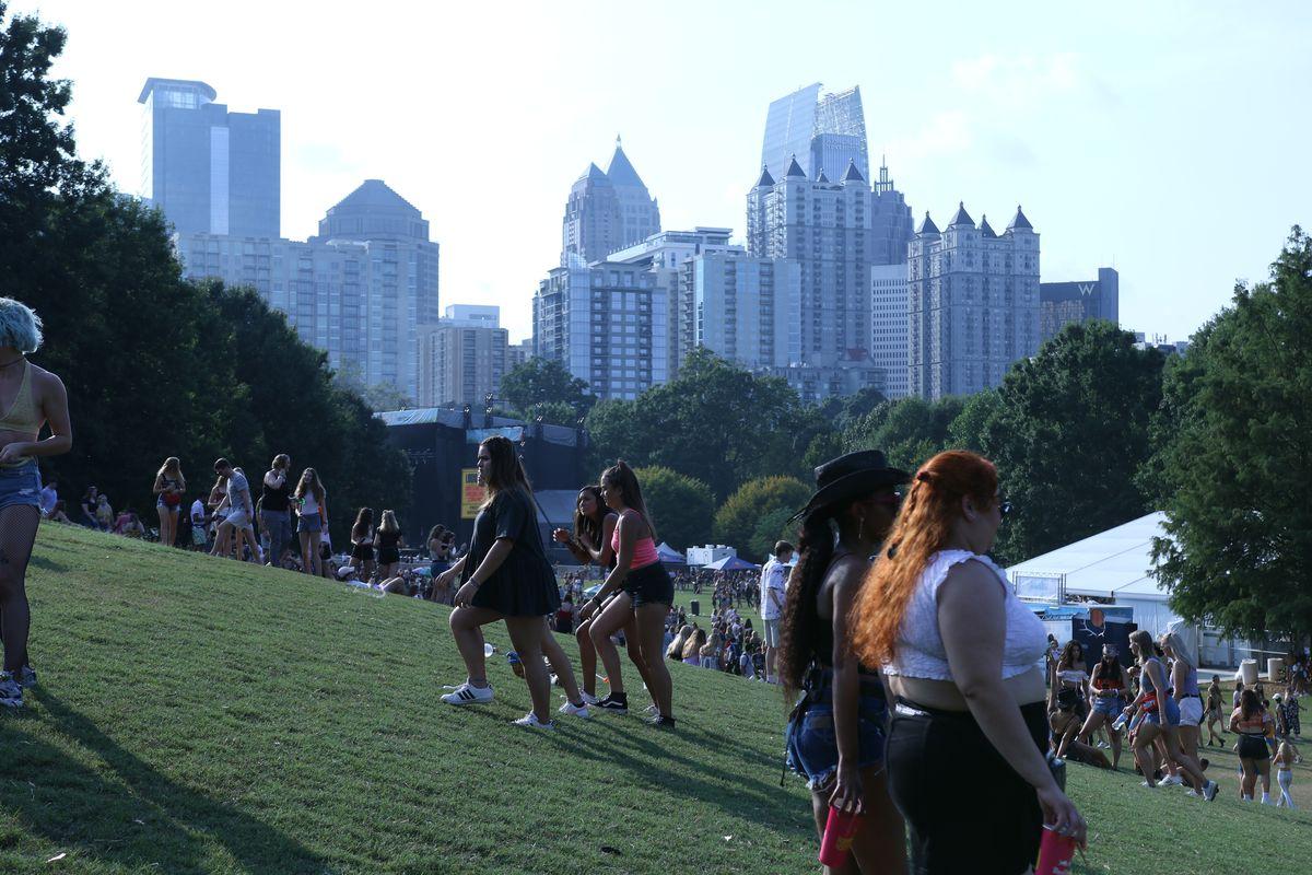 Midtown's skyline looms over the festivities.