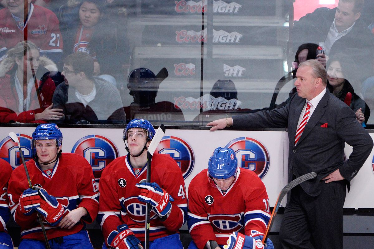 Feb 19, 2015; Montreal, Quebec, CAN; Montreal Canadiens head coach Michel Therrien looks on from the bench during the second period against the Florida Panthers at the Bell Centre. Mandatory Credit: Eric Bolte-USA TODAY Sports