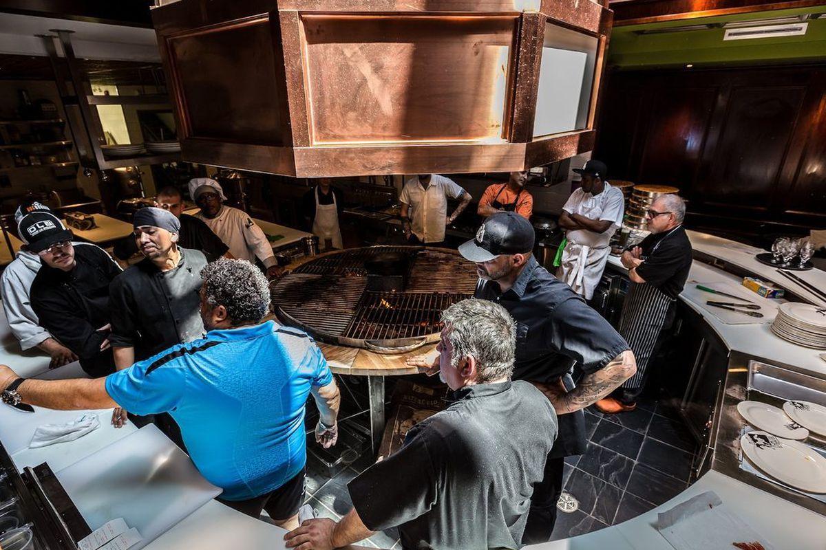 Peter Morentzos (in blue) directs staff at La Queue de Cheval