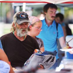 Food is handed out as homeless residents are treated to a picnic lunch in Pioneer Park in Salt Lake City on Sunday, Aug. 27, 2017. Participants also received a new blanket and listened to live music.