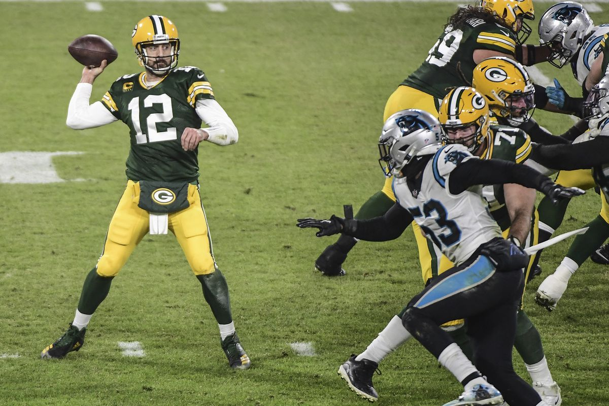 Green Bay Packers quarterback Aaron Rodgers (12) throws a pass in the second quarter during the game against the Carolina Panthers at Lambeau Field.