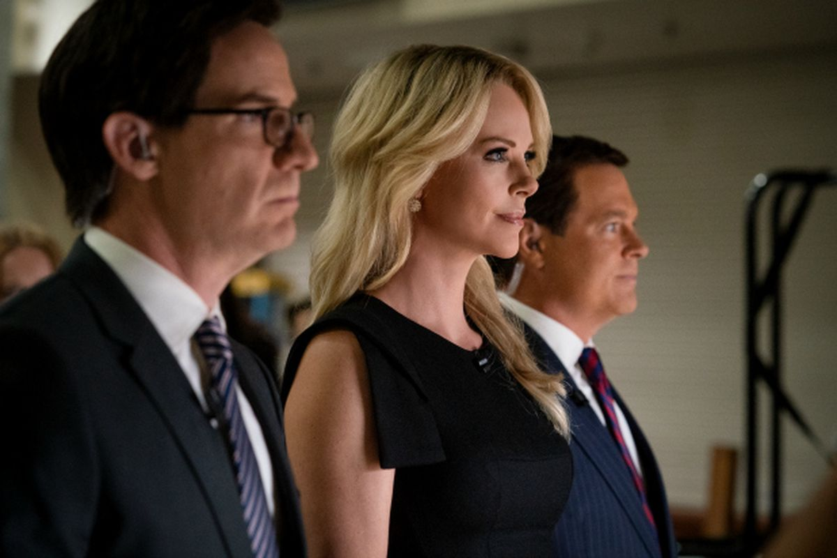 Three anchors from Fox News, including Megyn Kelly (played by Charlize Theron), in the movie Bombshell.