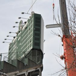 Girder being lifted into the right-center field patio -