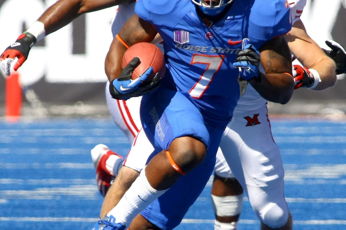 Sept.15, 2012; Boise,ID, USA; Boise State Broncos running back D.J. Harper (7) runs for a first down during first half action at Bronco Stadium verses the Miami Redhawks.  Mandatory Credit: Brian Losness-US PRESSWIRE