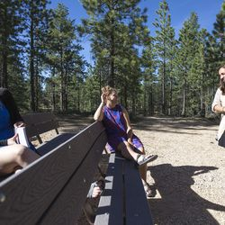 Amy Auble, left, Meleeza Hall and Gabi Sheeley tell funny stories from the work week before the 9:30 a.m. nondenominational Christian church service in Bryce Canyon National Park, Sunday, June 18, 2017.