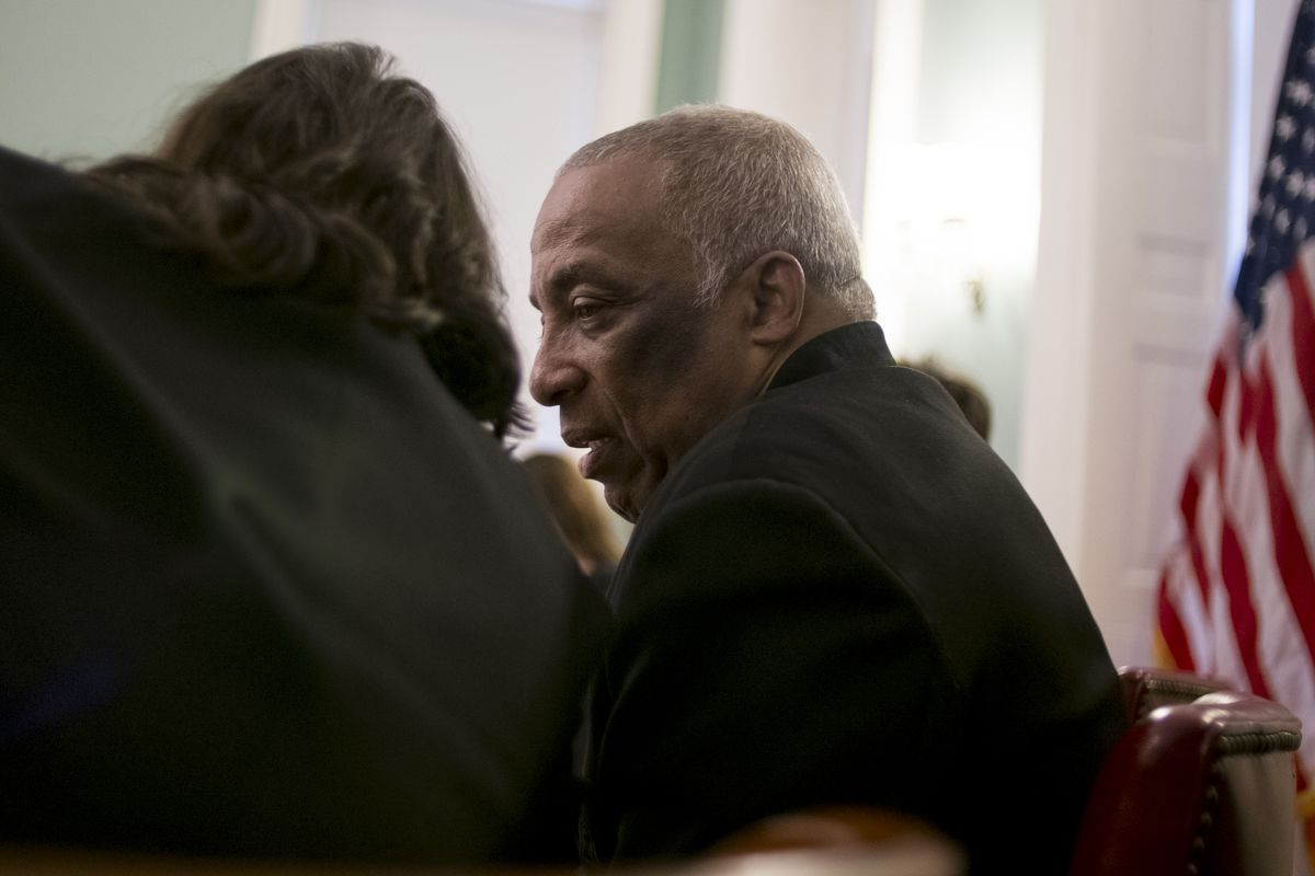 Council Member Charles Barron talks to CM Rosie Mendez during a land use vote on Dec. 10, 2013.