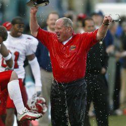 Coach Ron McBride celebrates winning after  Utah beat USC 10-7 in the Las Vegas Bowl on Dec. 25, 2001.